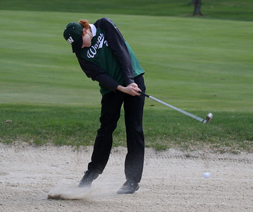 Photo by Herb Swanson:      Joe Bianchi hits out of a bunker on the first hole during a match at the Woodstock Country Club in Woodstock, Vermont on Tuesday May 17, 2016.
