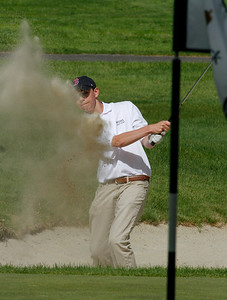Photo by Herb Swanson:      Kevan O'Connell hits out of the bunker on the first hole during a match at the Woodstock Country Club in Woodstock, Vermont on Tuesday May 17, 2016.