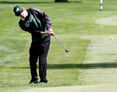 Photo by Herb Swanson:      Joe Bianchi chips onto the green on the first hole during a match at the Woodstock Country Club in Woodstock, Vermont on Tuesday May 17, 2016.