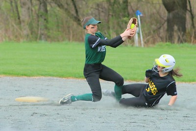 Gabby Rozumek tags a runner out at second