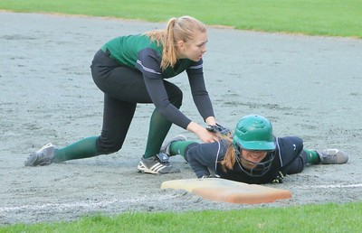 Elizabeth Fitzpatrick tags a runner out at first who took too big a lead