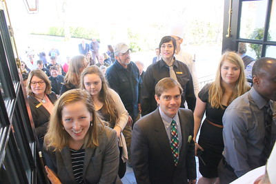 IMG_6941 employees Crys Szekely and garrett kelly, in front, and other employees, enter new lobby for first time