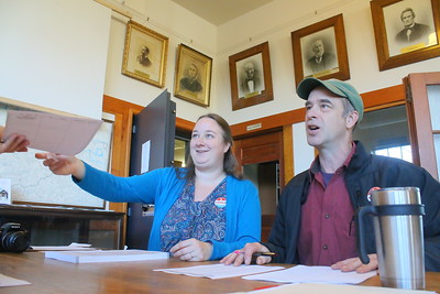 IMG_4633 town clerk becky fielder and her dad frank perron check in voters