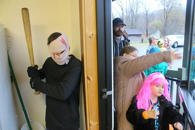 IMG_3140 BEST  robby macri trying to scare people coming into the town hall at left with addison blanchard at right coming in door