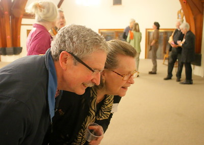 IMG_5714 owen McDowell and Marilyn Milham, who both have art in show, look at other art