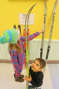 IMG_9144 megan henderson,10, and micah mahood,5, looks over skis for sale