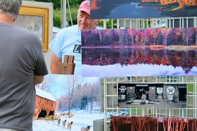 IMG_2206 richard cofrancesco stands behind display of his photos
