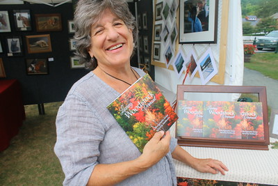 IMG_2195 Gerry Sandweiss with a book of local photos that was just published, she said it is a love letter to woodstock