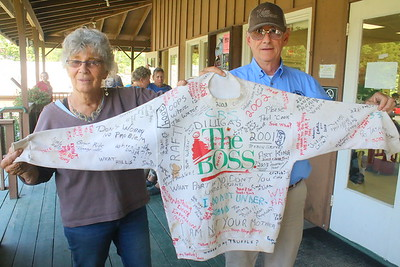 IMG_1843 former 100 mile ride director Betty Welles holds up a sweatshirt she has had since 2001 that she collected quotes overheard from participants in the event,,She has never washed it    with former ride judge Art King