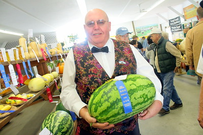 IMG_2876 clyde jenne with his prize winning watermelon 28 and half pounds been doing this since 2000