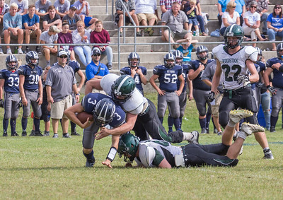 Caleb Webb looks on as Hunter Balch and Andrew Buchan-Groff make a tackle