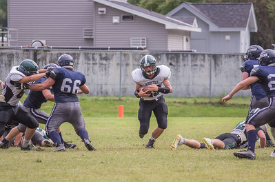 Caden White carries the ball