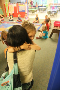 IMG_0603 lorissa segal hugs her daughter isla, at right, as she goes into kindergarden