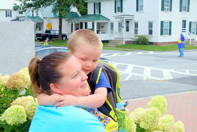 IMG_0572 hunter putnam hugs his mom danielle before his first day  of preschool