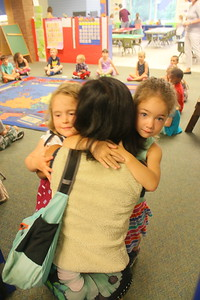 IMG_0607 lorissa segal hugs beatrice ziobro at left and her daughter Isla at right as they start kindergarden