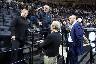 Rick Mount talks with Brian Cardinal and Morgan Burke prior to the Purdue Boilermakers basketball game against  Iowa on January 2, 2016
