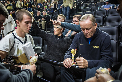 Rick Mount signs an autograph for a fan prior to the Purdue Boilermakers basketball game against  Iowa on January 2, 2016