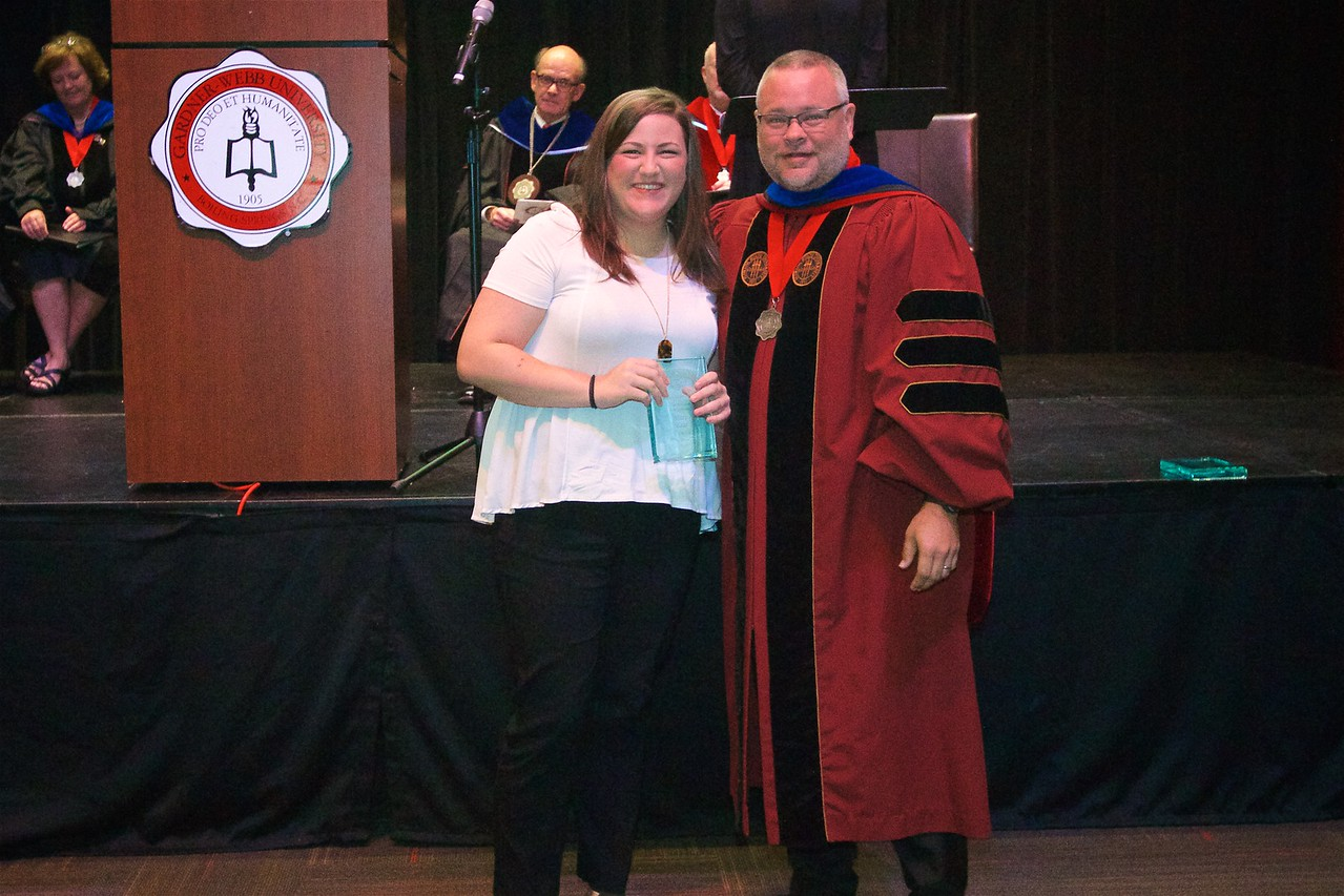 THE J. CALVIN KOONTS POETRY AWARD - Is a prize awarded to the senior who shows the greatest potential for writing poetry. The Koonts Poetry Award goes to MaryKate Powell.