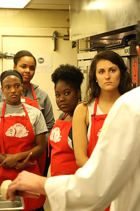 Students listen intently to Chef Bob Katz as he shows them what they will be making.