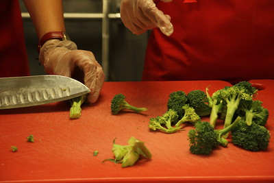 Students learned how to cut up broccoli.