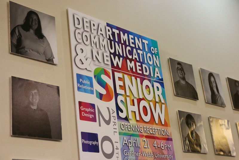 The entrance to the show was decorated with this graphic piece, which was created collaboratively by multiple seniors, and surrounded by head shots of all of the graduates.
