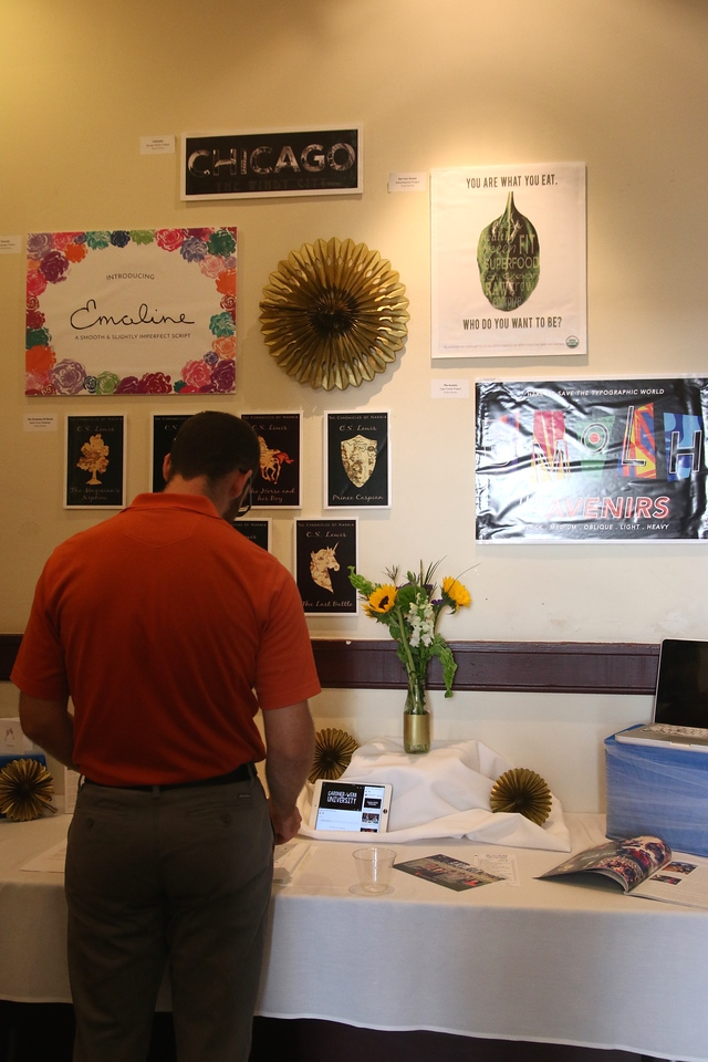 A local community member looks at Emily DeVries' display.