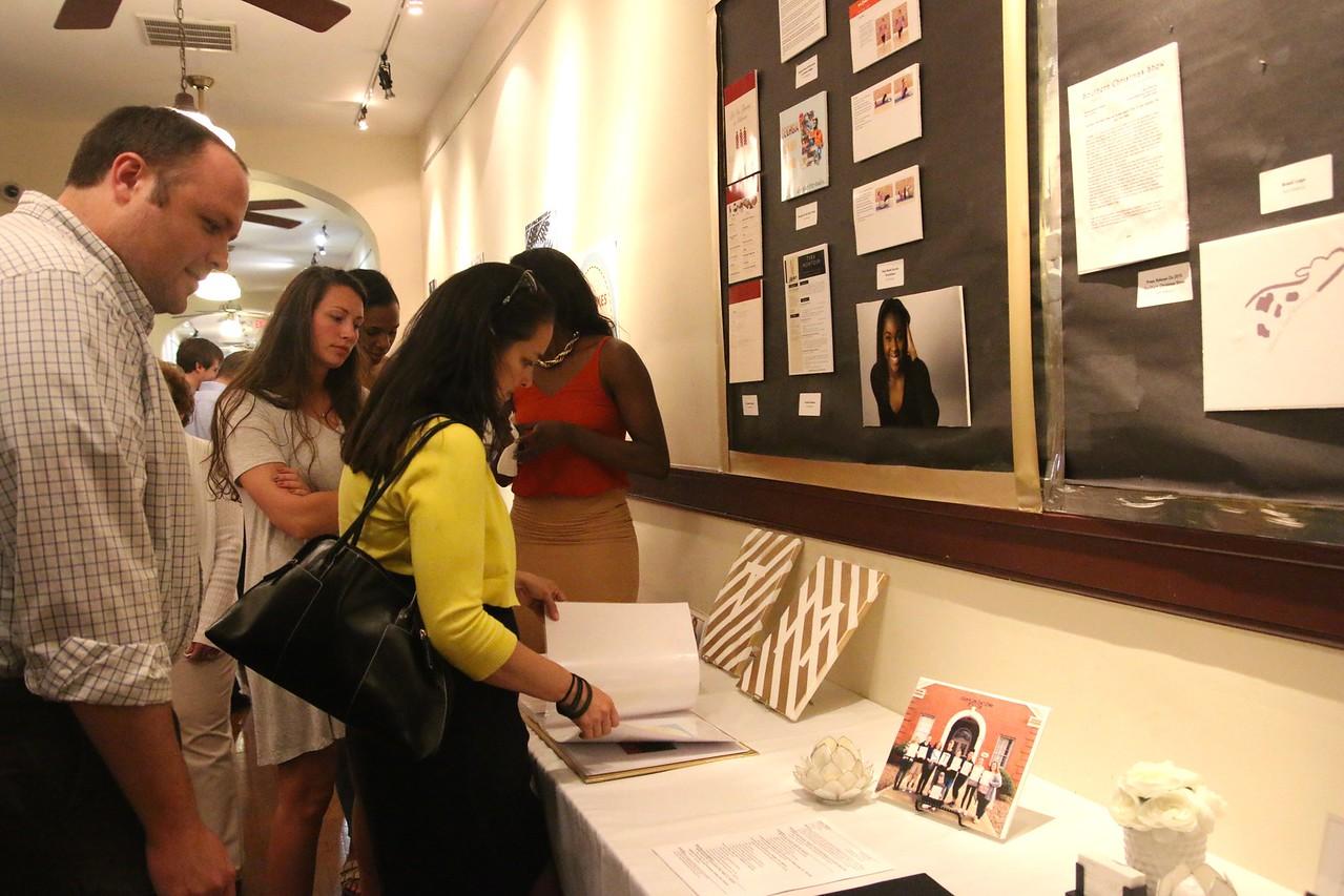 Community members looking at Tyra Montour's display.