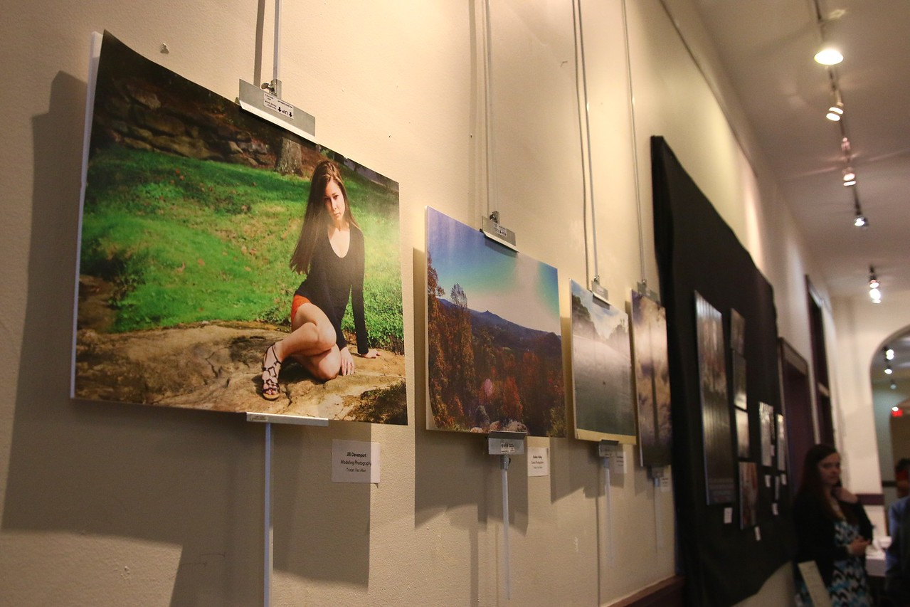 Tristen Van Aken's senior show display was lined with photographs as well as graphic design pieces.