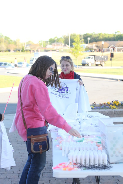 Photo by Tessa Walsh Students picking up their T-shirts and glow sticks