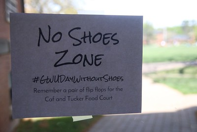 Signs were posted around campus reminding students to take off their shoes.