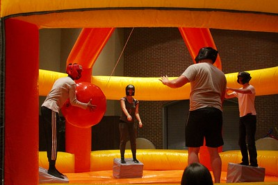 Inside the halls in Tucker Student Center, Student Activities set up bounce house style games for students to challenge each other in.
