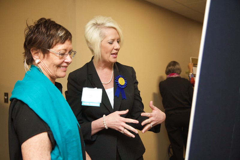 Nursing students and professionals were given a chance to present their research projects and findings to regional nursing and healthcare employees and community members during the 50th Anniversary of the Nursing Program at Gardner-Webb University. Susan Cannon discusses her research with symposium speaker and special guest Jean Watson.