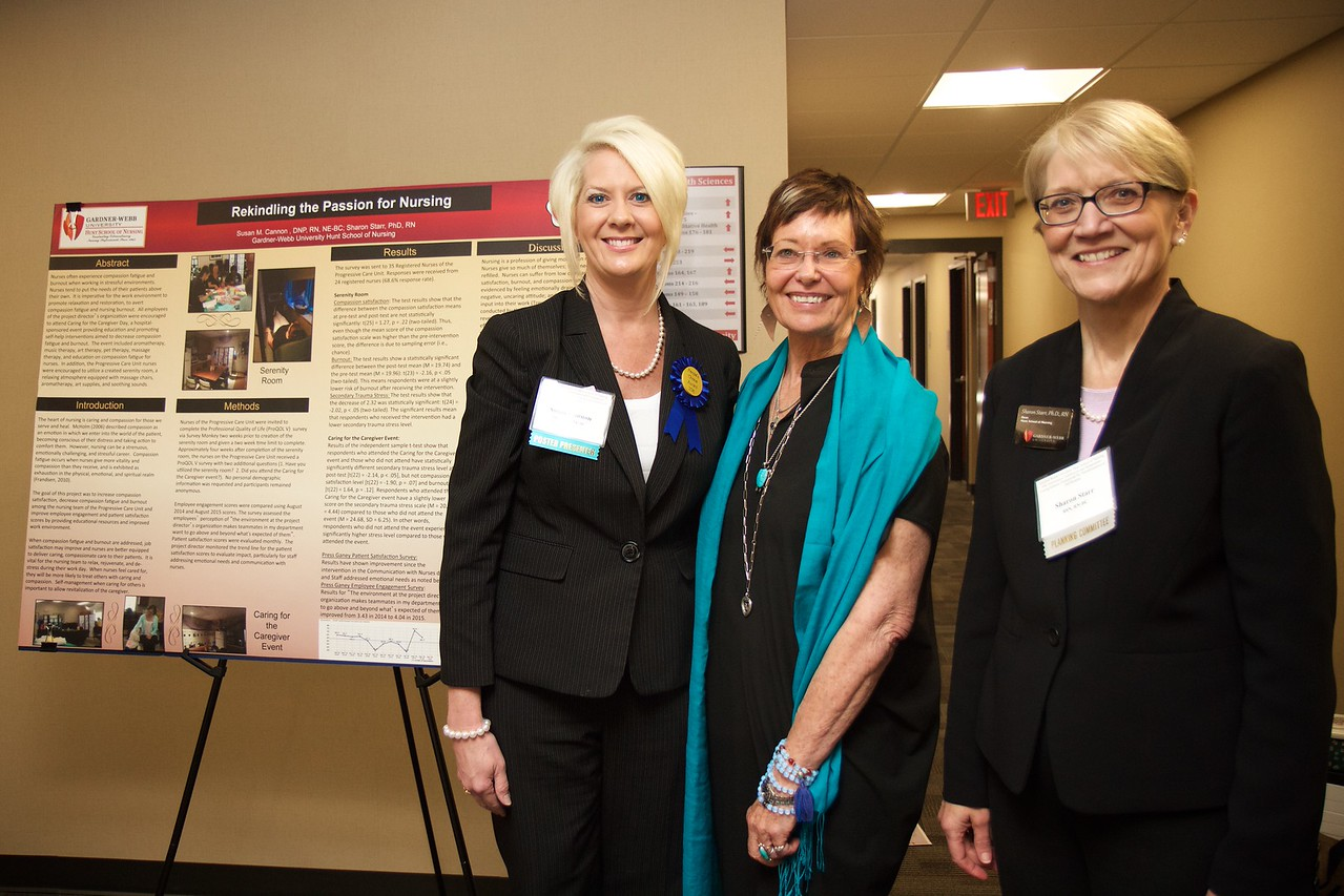 Nursing students and professionals were given a chance to present their research projects and findings to regional nursing and healthcare employees and community members during the 50th Anniversary of the Nursing Program at Gardner-Webb University. Susan Cannon poses with special guest Jean Watson and Dean of the Hunt School of Nursing Sharon Starr for a photo in front of her research presentation.