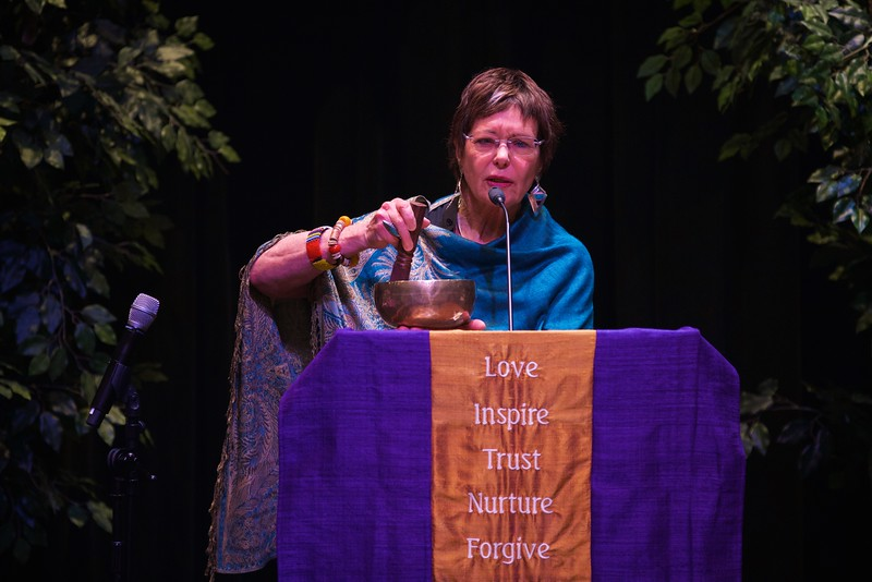 Nursing 50th Anniversary. Jean Watson demonstrates Caritas philosophy as she connects with the audience using a singing bowl.