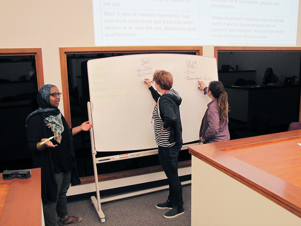 RESESS interns discuss best practices for resumes, CVs, and cover letters in their Communications Seminar, run by UNAVCO staff at the UNAVCO Boulder facility. Friday, May 27, 2016. (Photo/Melissa Weber, UNAVCO)