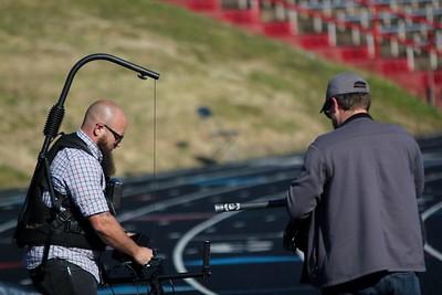 Cameramen preparing their equipment to film