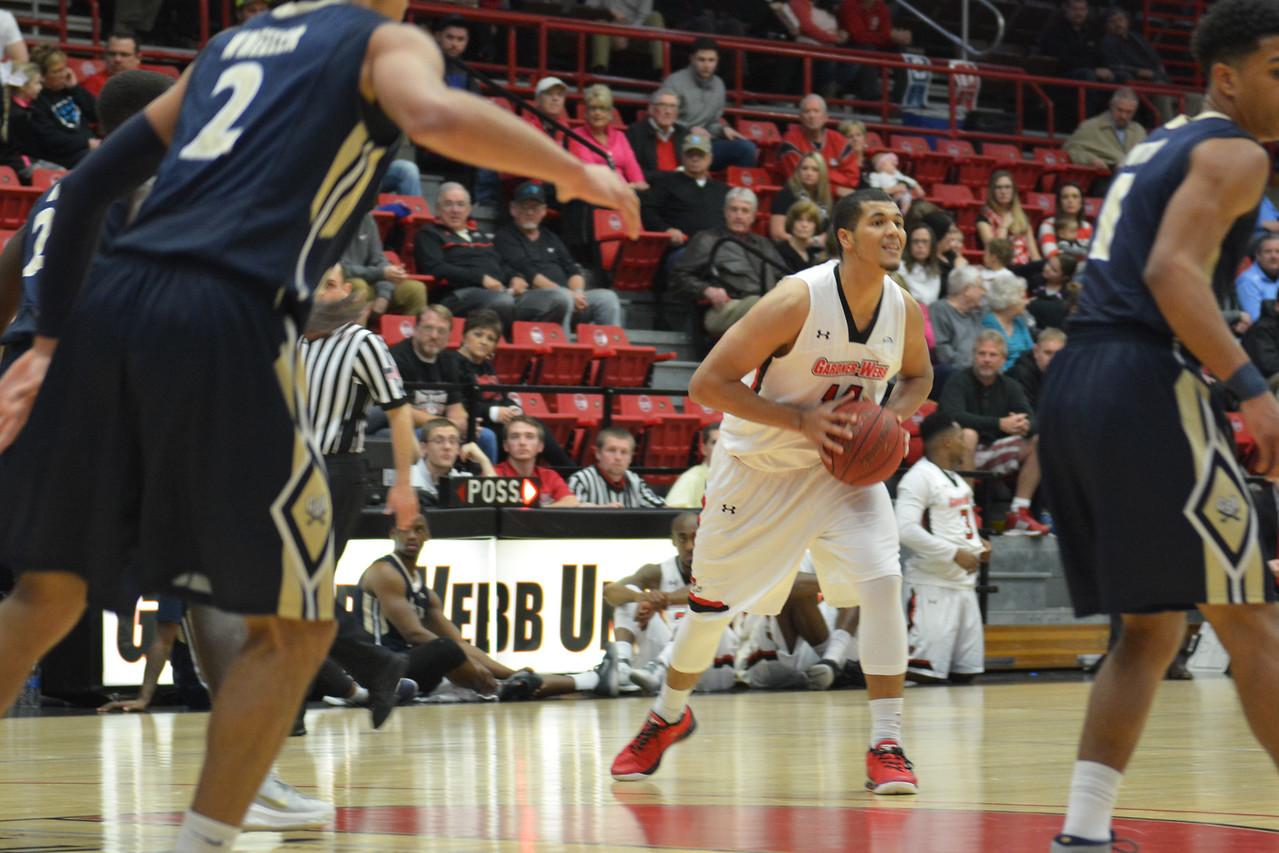 Brandon Miller passing the ball
