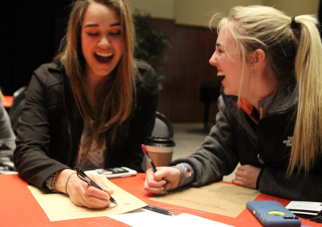Some Freshmen have fun learning calligraphy at the release event Thursday night.