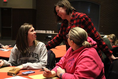 Sydney Moore, Hannah Boehmer, and Jessica Francis share tips about calligraphy at the Release Calligraphy event.