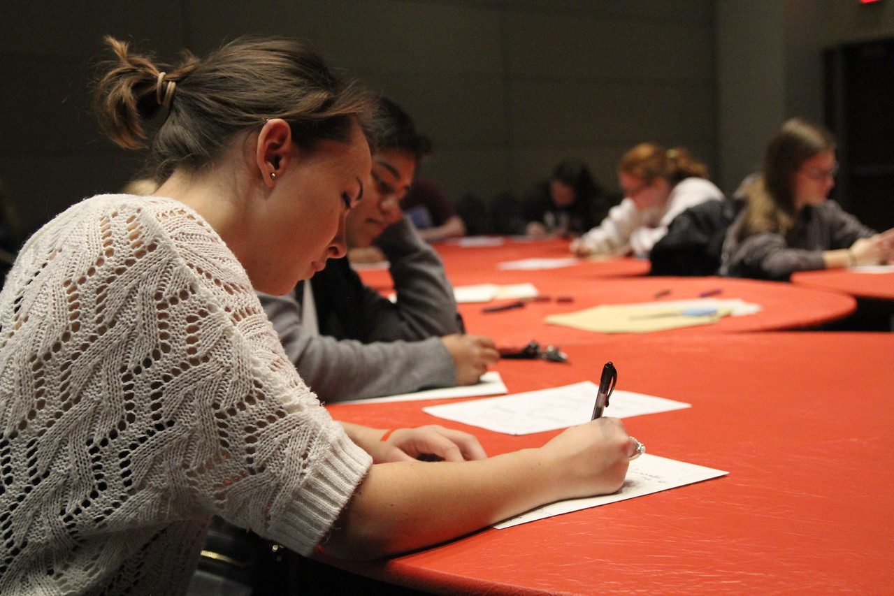 Mallory Turner works on her calligraphy using the verse Isaiah 61:10.