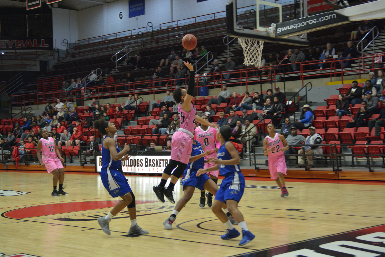 Number 25, Alexus Hill shooting the ball