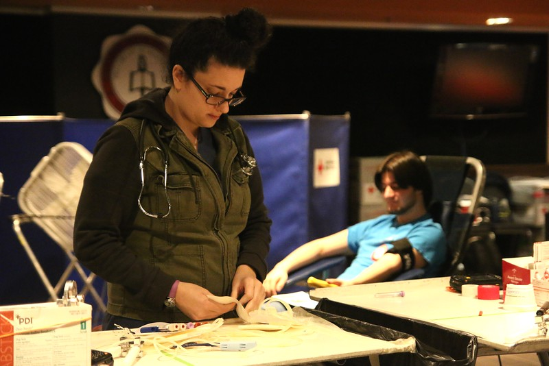 A nurse preparing the tools needed while a GWU student waited in the chair behind.