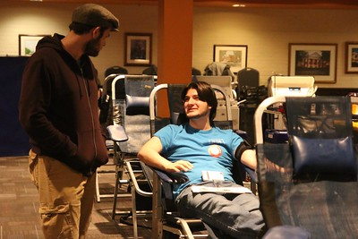 Two students talking while waiting to donate blood.