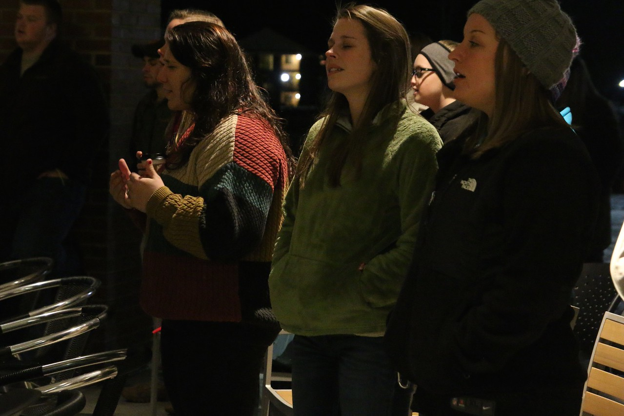"GWU seniors, Brittney Kertesz and Ruth Anna Housand, and GWU Campus Ministries intern, Mindy Robinson worshipping to the song ""Lord I Need You."""