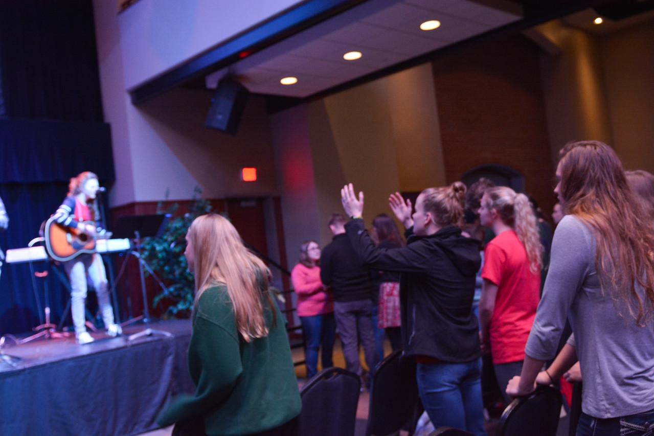 Students singing in praise on Thursday Night