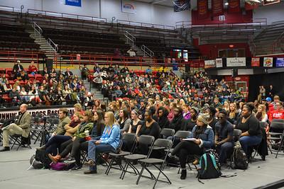 Students listening to Dr. Albert Brinson speak.