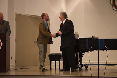 Passing of the Pi Kappa Lambda charter to initiate the Gardner-Webb Chapter of the national honors society for music, and induction ceremony. Dr. Bruce Moser