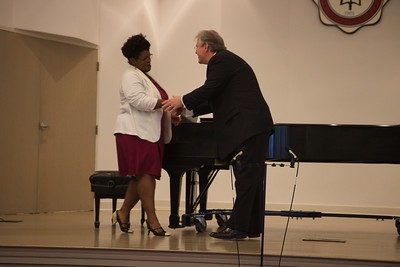 Passing of the Pi Kappa Lambda charter to initiate the Gardner-Webb Chapter of the national honors society for music, and induction ceremony. Professor Jondra Harmon