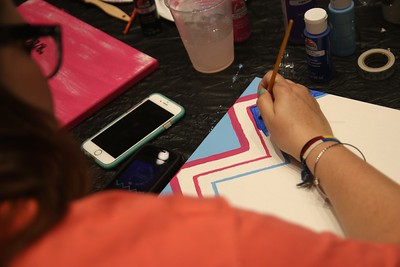 Sophomore, Maryn Long, painted blue and pink chevron on a canvas.