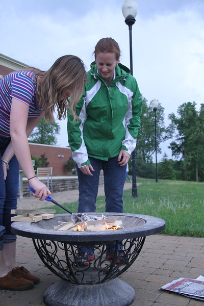 Caitlyn Brotherton and Sarah Curry set up the fire for smores